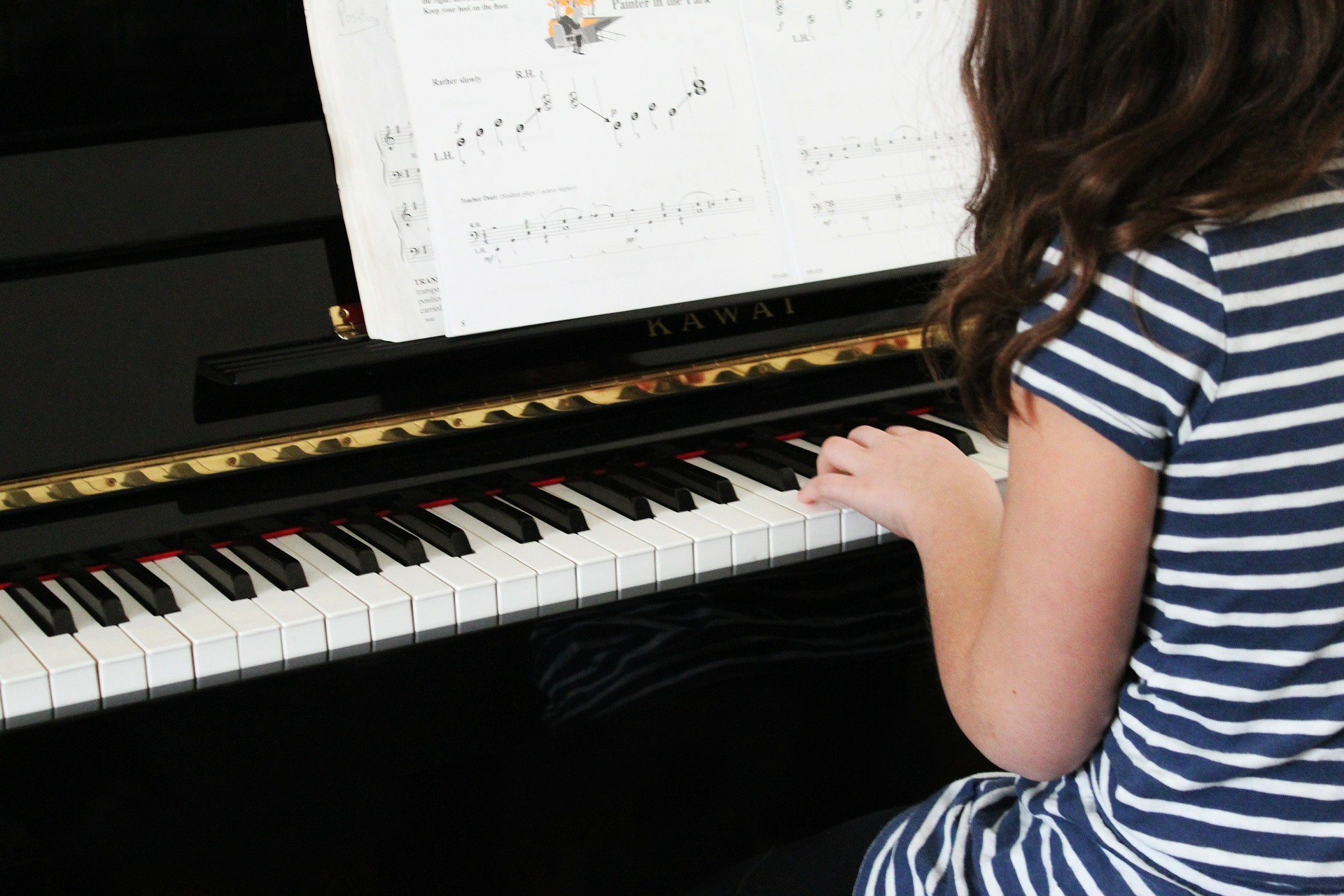 Female student practicing piano